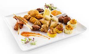 Brakes Indian platter contains vegetable pakora 15 onion bhaji vegetable samosa and aloo tikki