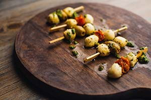Menuserve Mediterranean Buffet Skewers from Central Foods close up on dark wood lscape medium